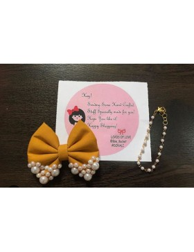 Mustard attachable bow with white pearls